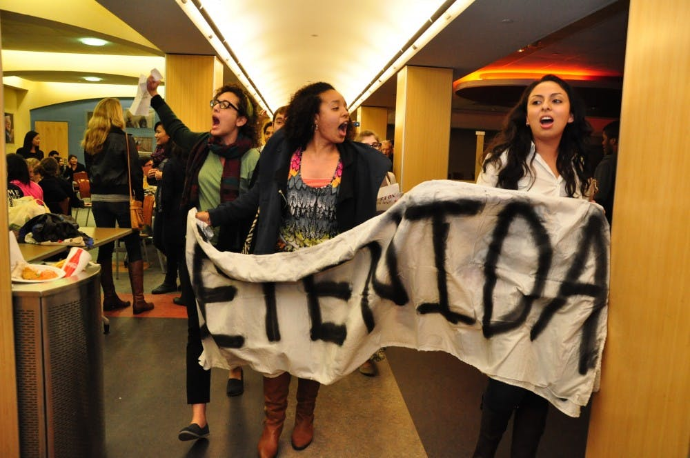 Students protest Brewer's speech