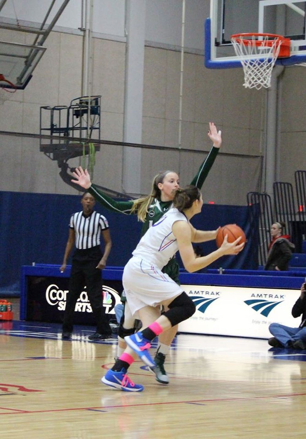 Women's basketball fights back to knock off Navy in finale