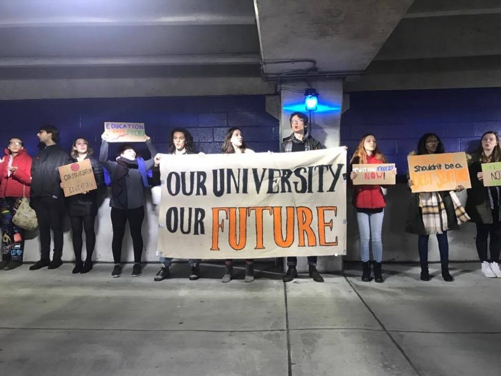Education Not Debt members protest against tuition hikes