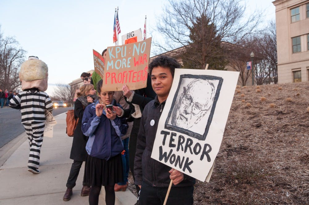 Students gather outside of Bender Arena to protest Dick Cheney