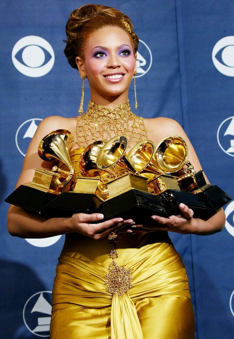 LOS ANGELES - FEBRUARY 8:  Singer Beyonce Knowles poses with her six Grammys backstage in the Pressroom at the 46th Annual Grammy Awards held at the Staples Center on February 8, 2004 in Los Angeles, California.  (Photo by  Frederick M. Brown/Getty Images)