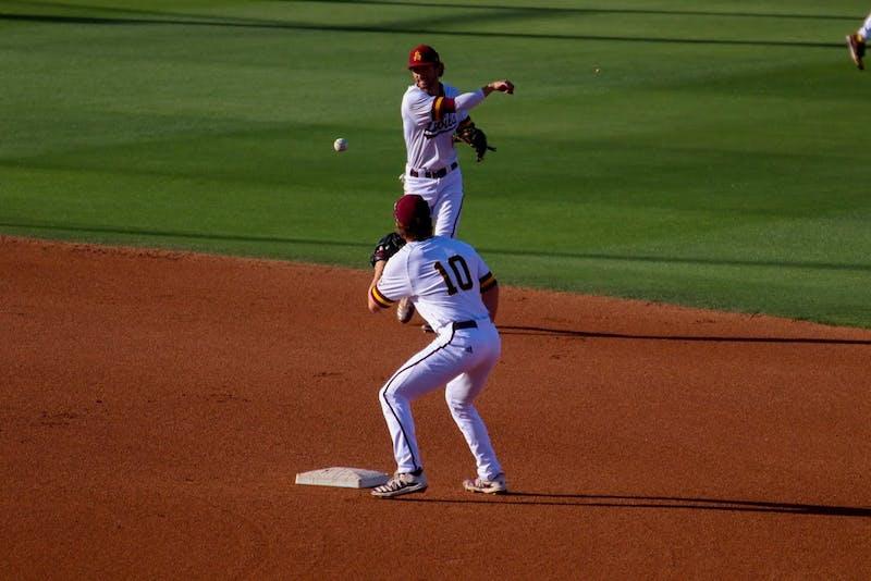Drew Swift (6) throws to Sean McLain (10) on second base