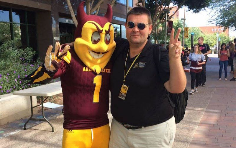 ASU public service senior James Deibler poses for a photo with Sparky the Sun Devil on ASU's downtown campus on Tuesday, Oct. 18, 2016.