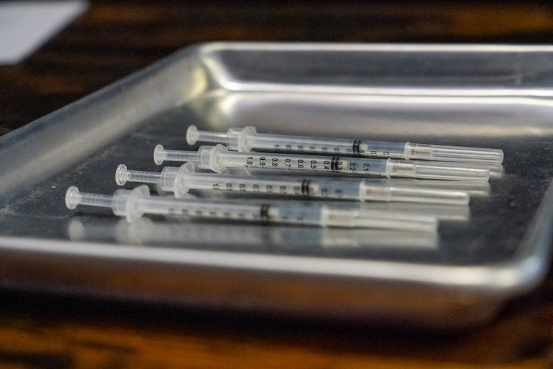 Four syringes containing the Pfizer COVID-19 vaccine are shown