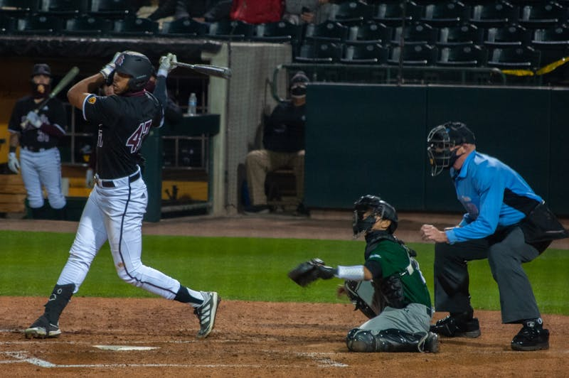 Allbry Major (47) takes a swing during the game against University of Hawai'i.