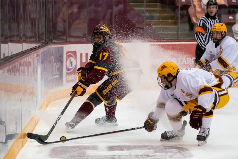 Jacob Semik (17) battles for the puck against Minnesota.