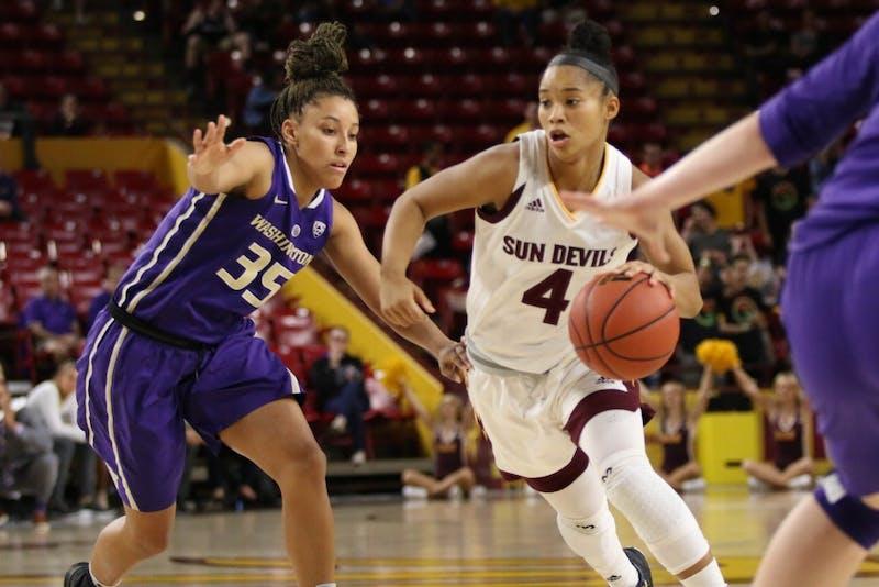 Kiara Russel Drives Towards Basket