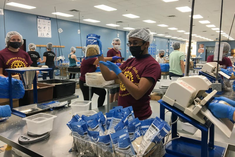 ASU Students from the Rotaract club give their time at Feed My Starving Children and help pack food on Saturday, September 19, 2020 in Mesa, Arizona.