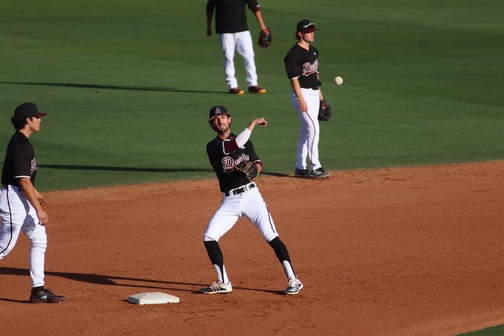 Drew Swift (6) throws to the mound