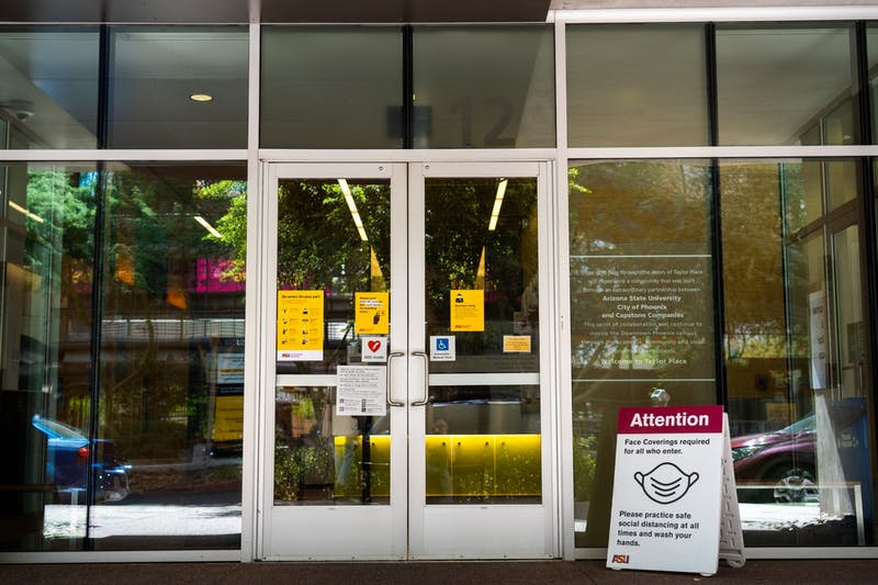 Community of Care signs posted at the entrance of the Taylor Place Dorms on the ASU Downtown Phoenix campus are pictured on Wednesday, Sept. 16, 2020.