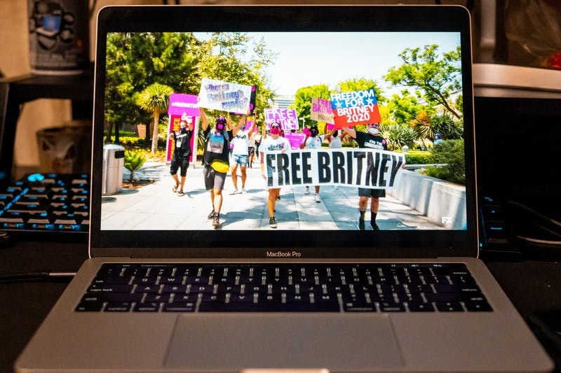 "A laptop playing the ""Framing Brittney Spears"" documentary is shown."