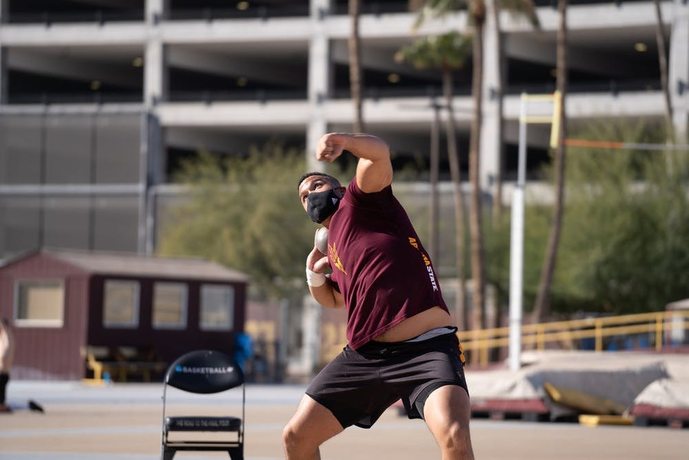 ASU redshirt junior thrower Turner Washington winds up a practice shot put