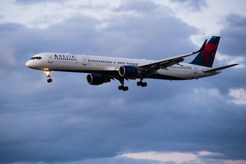 A Delta Air Lines flight from Minneapolis makes its approach into Phoenix Sky Harbor International Airport on Thursday, March 19, 2020.