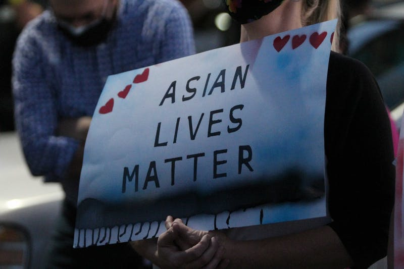 """A sign that reads """"Asian Lives Matter"""" is shown"""