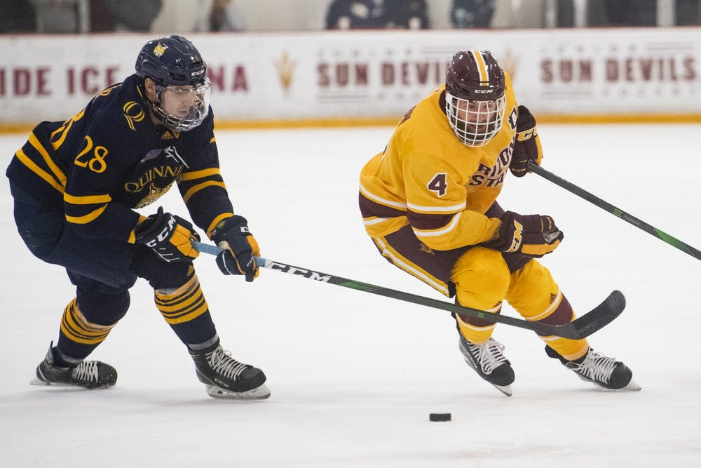 Jacob Wilson (4) tries to take the puck from Joe O'Connor