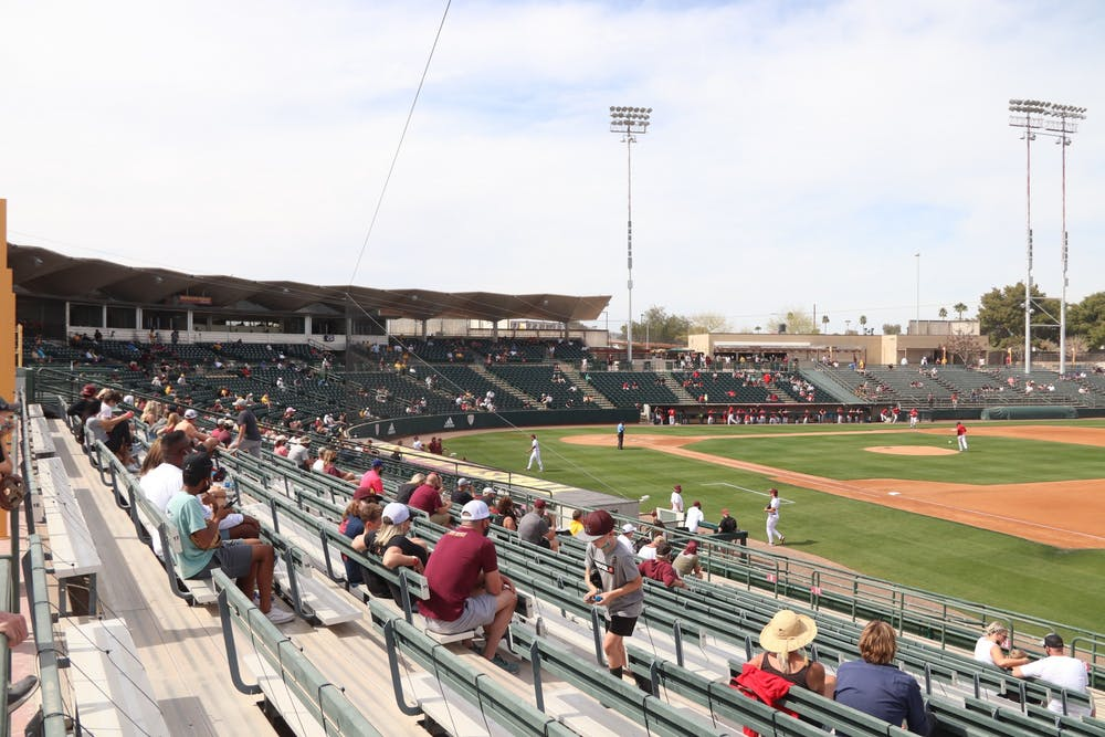 Socially-distant fans watch an ASU baseball game