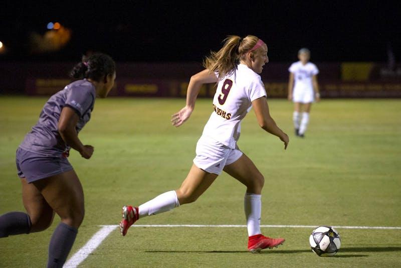 ASU now-junior forward Nicole Douglas (9) dribbles the ball
