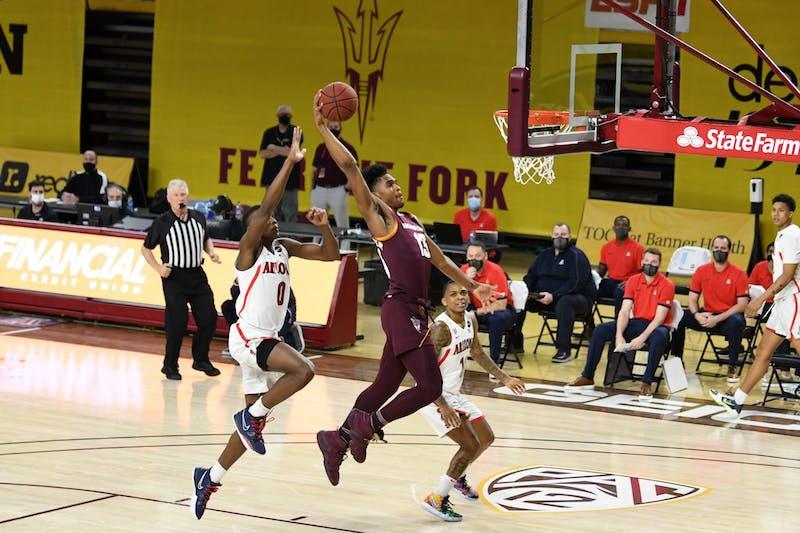 ASU freshman guard Josh Christopher (13) shoots the ball against UA