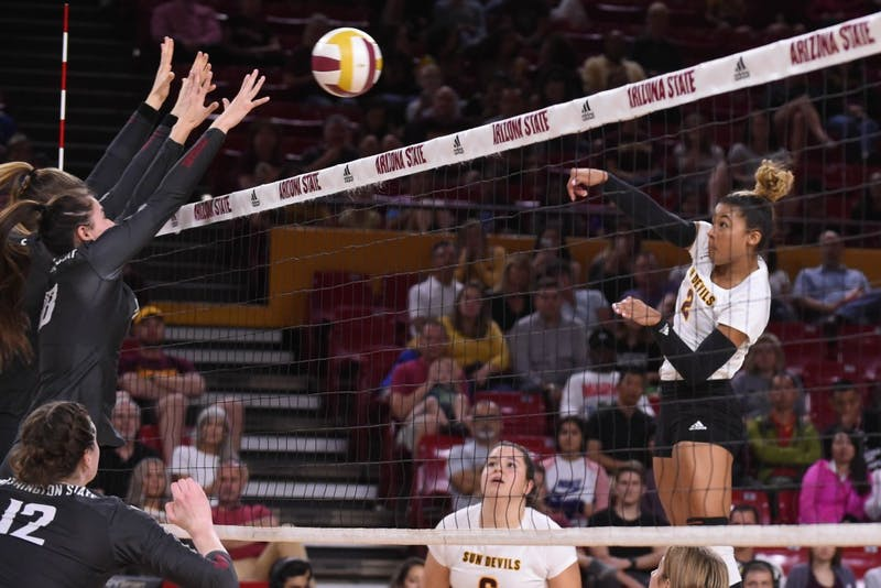 ASU senior outside hitter Alyse Ford (2) spikes the ball in a game against Washington State