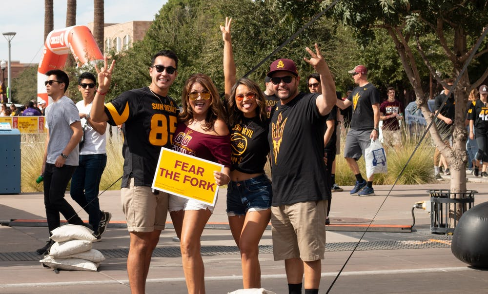 A family posing for a photo at family weekend at ASU.