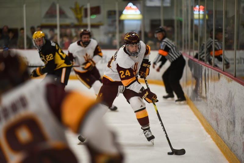 ASU now-sophomore defenseman Joshua Maniscalco (24) handles the puck in ASU's 5-4 overtime victory over American International in Oceanside Ice Arena in Tempe on Saturday, Feb. 17, 2019.