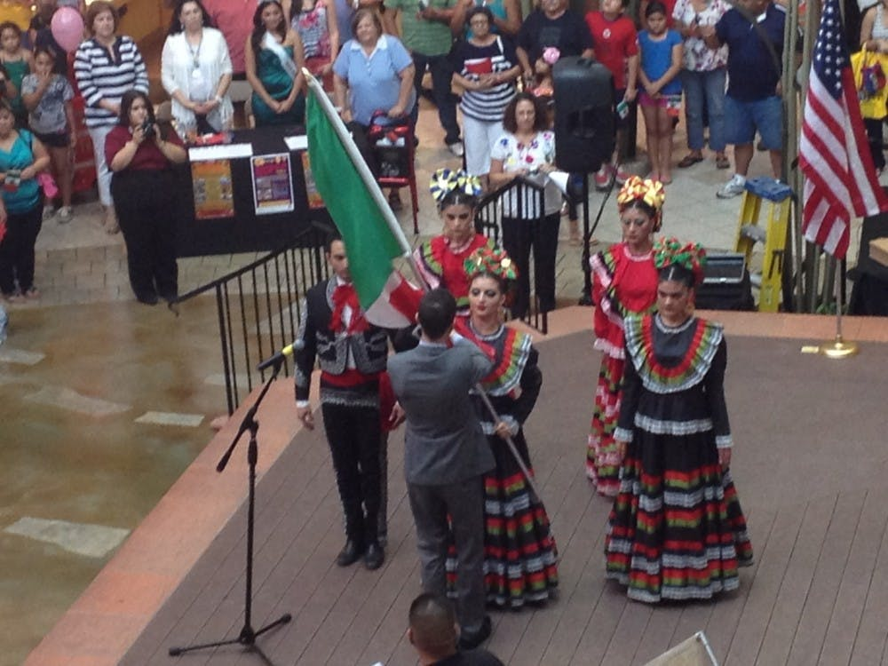 fiesta-mall-colorguard-dressed-in-traditional-mexican-costume-give-the-mexican-flag-to-the-consulate