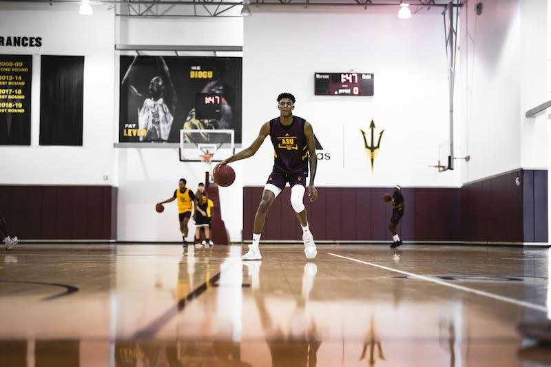 ASU player Alonzo Gaffney dribbles basketball in Weatherup center.