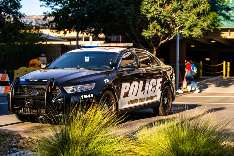 ASU Police Department car pictured blocking traffic during Sparky's Tailgate.