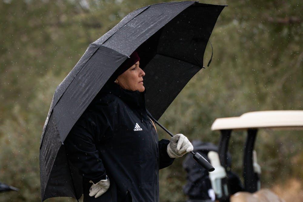 ASU women's golf head coach Missy Farr-Kaye watches her team play in the rain