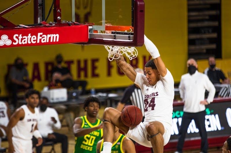 Jalen Graham (24) dunks the ball against Oregon