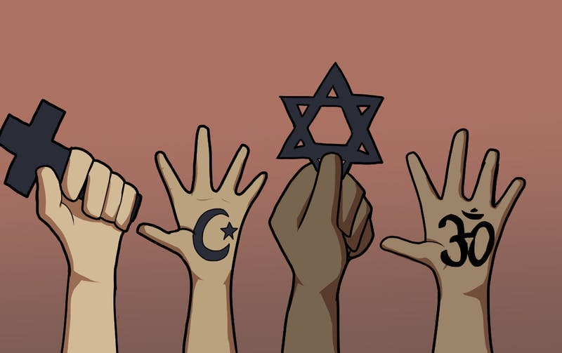 A bunch of hands holding up different symbols of religion.