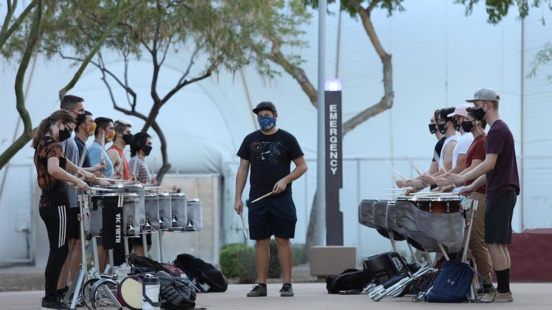 Arizona State University Sun Devil Percussion practices at Verde Dickey East Athletic Field on Friday, Oct. 9.