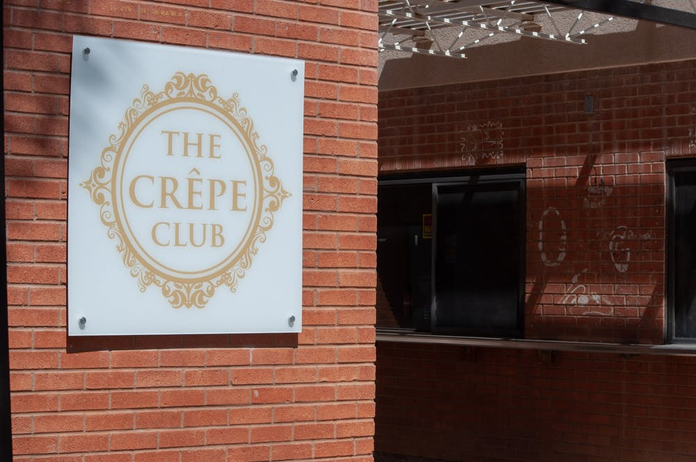 A sign for the Crepe Club is shown in Tempe, a local closed business, is shown.