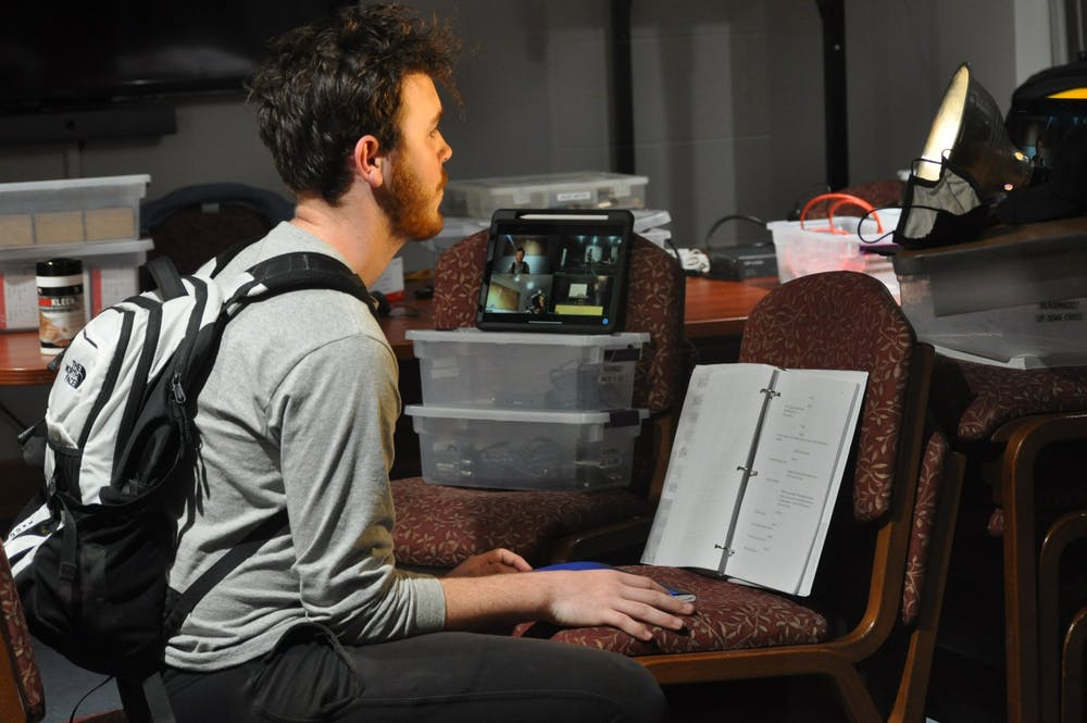 A picture of Liam Boyd sitting and practicing for the role of Joseph in Light Switch.