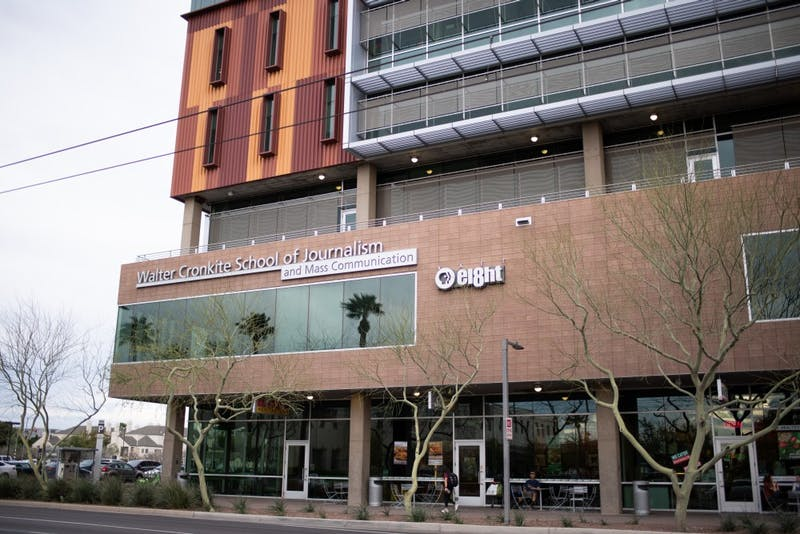 A person walks past the Walter Cronkite School of Journalism and Mass Communication, also home to AZPBS