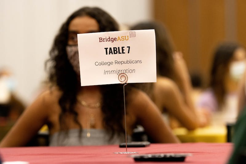 Sign on table in the Student Pavilion that says