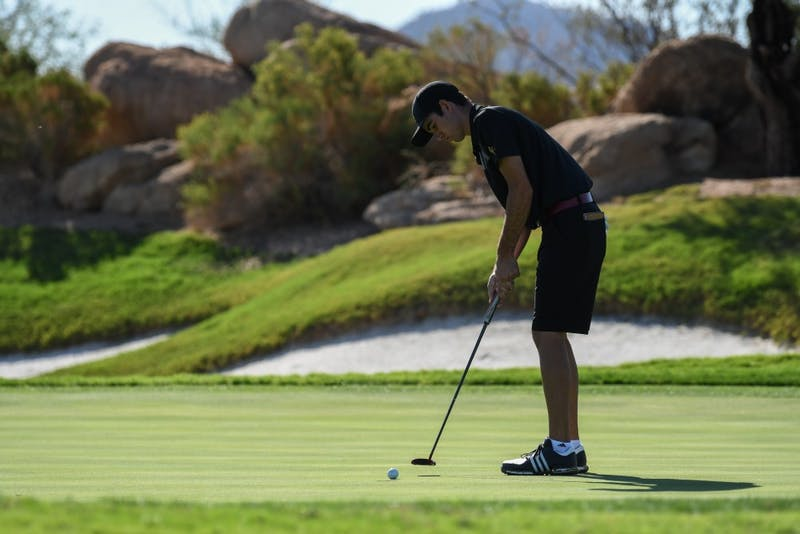 Cameron Sisk putts the golf ball
