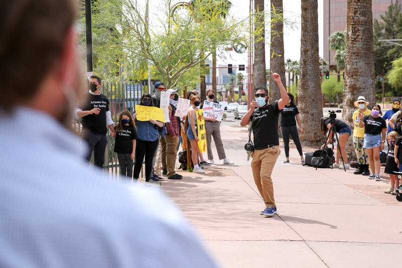A members of Arizona Jews for Justice lead a protest calling for immigration rights.