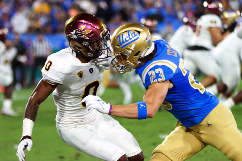 ASU player blocks UCLA player at the Rose Bowl.