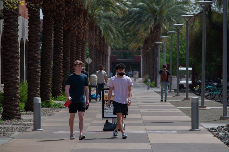 Students walk down Palm Walk