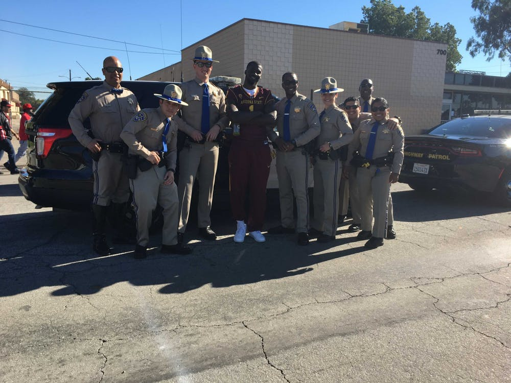 Former ASU wide receiver Mike Willie posses with Compton sheriffs