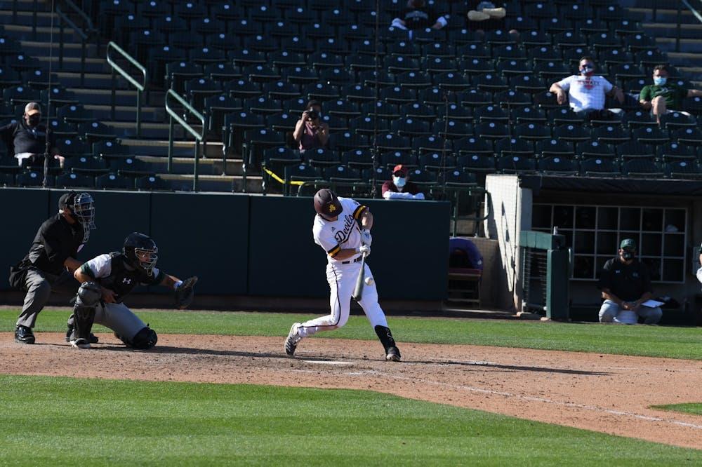 Sean McLain (10) hits the baseball against University of Hawai'i