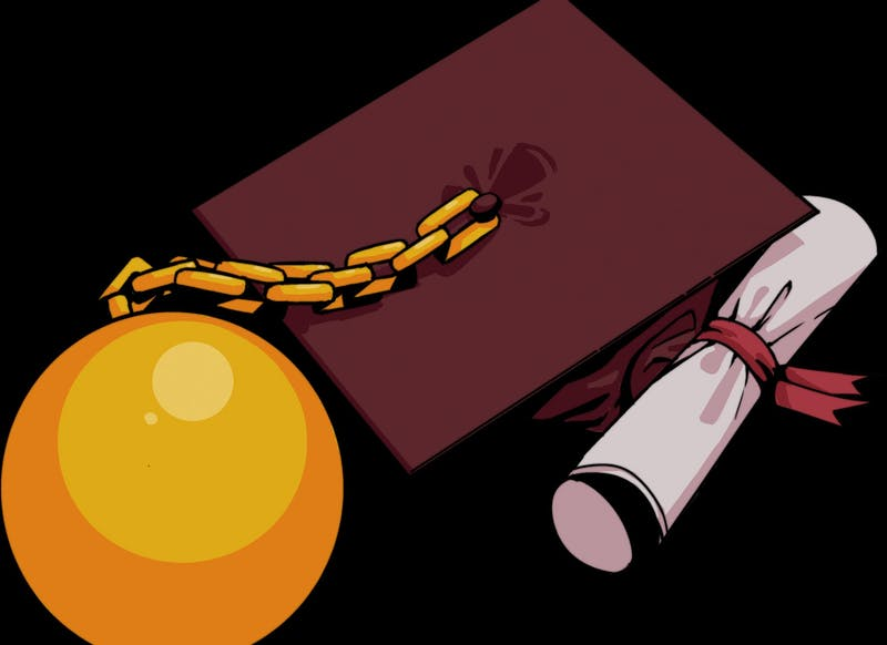 An ASU graduation cap is held down by a golden ball and chain.