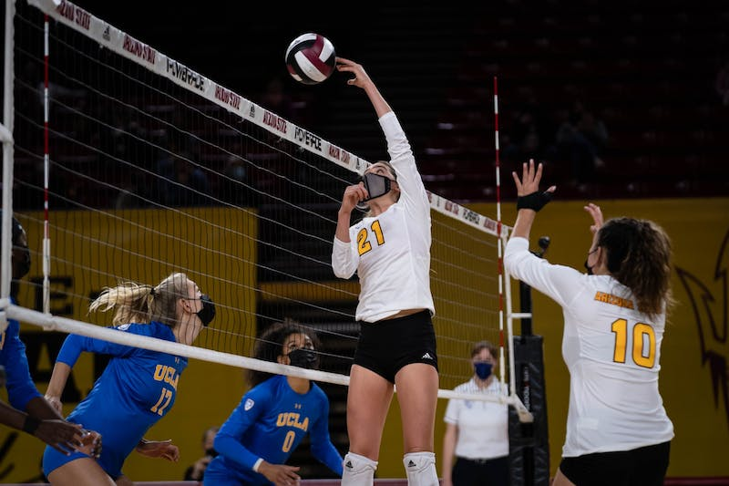 Ella Snyder tips the volleyball over the net