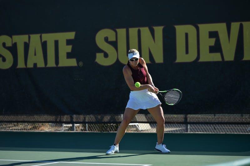 ASU women's tennis senior Ilze Hattingh hits the ball across the court during a game against GCU