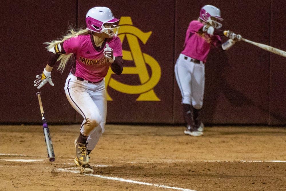 Kindra Hackbarth (22) prepares to run to first base