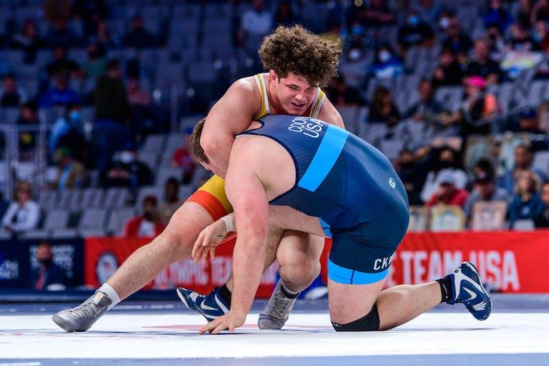 Colton Schultz wrestles Adam Coon