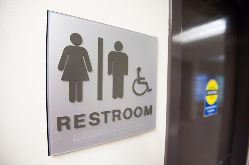 A gender-neutral restroom sign