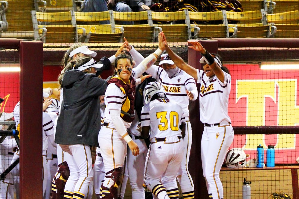 The ASU softball team celebrates their victory