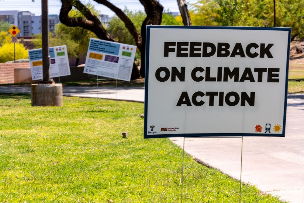 """A sign that reads """"feedback on climate action"""" is shown"""